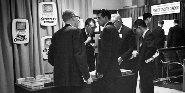 Bill Cook makes and sells catheters on the floor of the Radiological Society of North America meeting in the fall of 1963.